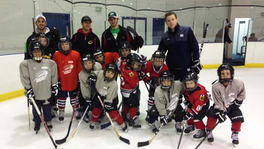 Group of ice hockey players and coaches after a practice scrimmage.