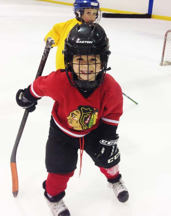Youth at hockey lessons in a red jersey