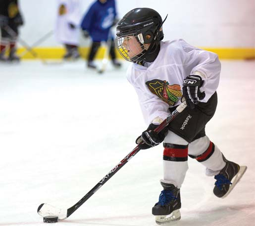 Hockey Player wearing a blakhwaks jersey practices at hockey lessons