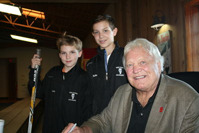 Bobby Hull with 2 hockey players