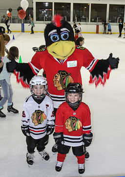 Blackhawks youth hockey players with Tommy Hawk.